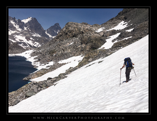 Nick Carver navigating the trail with crampons along Cecile Lake